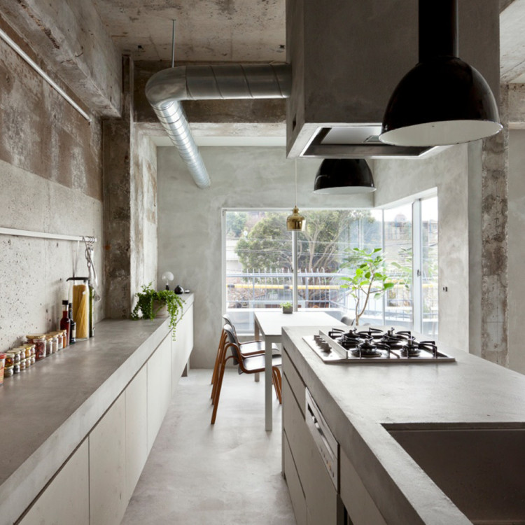 concrete house by Airhouse Design with vintage lighting from skinflintdesign.com