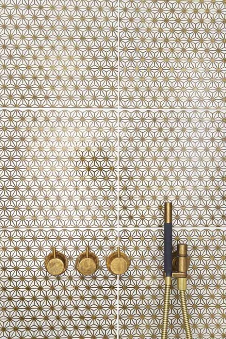 brass vola taps on mano a mano gold tiles from laurence pidgeon