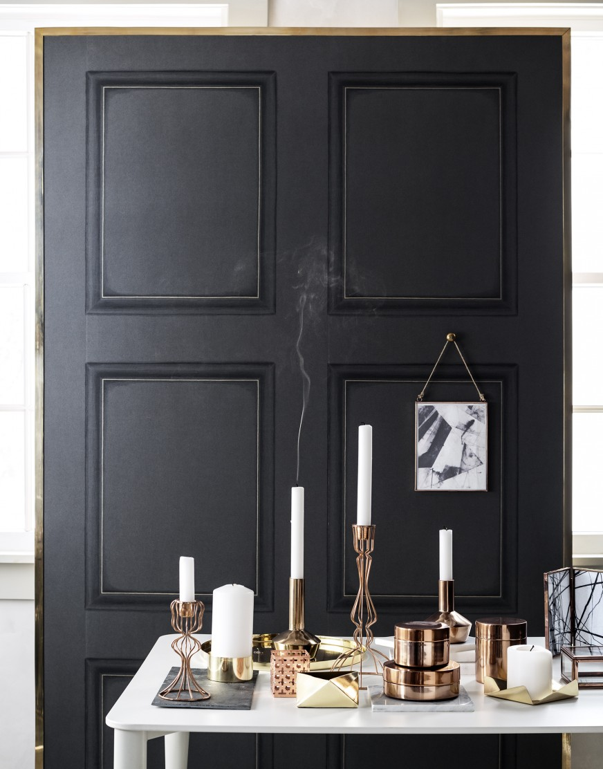 black walls and copper candlesticks