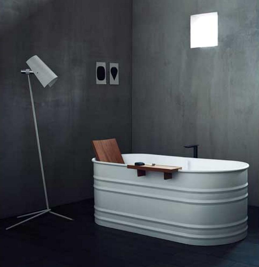 freestanding bathtube concrete wall from westonebathrooms.com