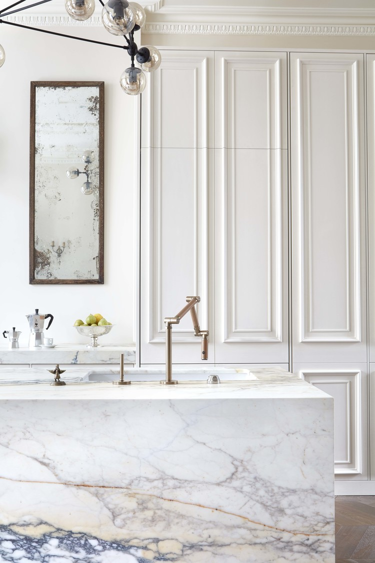 marble kitchen island and panelled walls by blakes london
