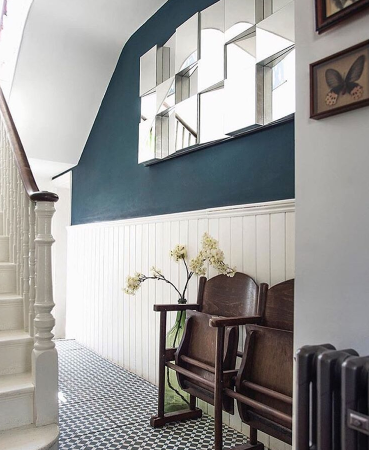 blue hallway with panelling by homeplaceonline