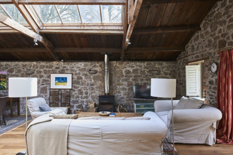glass roof sitting room exposed brick wall
