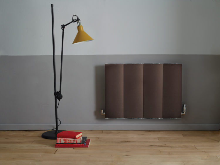 half painted wall featuring bisque radiator
