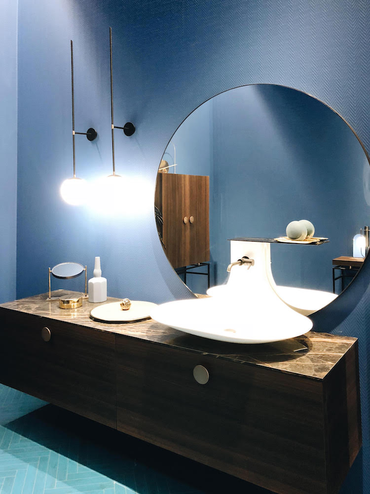 blue was strong with round mirrors, curved basins and baths and wooden furniture