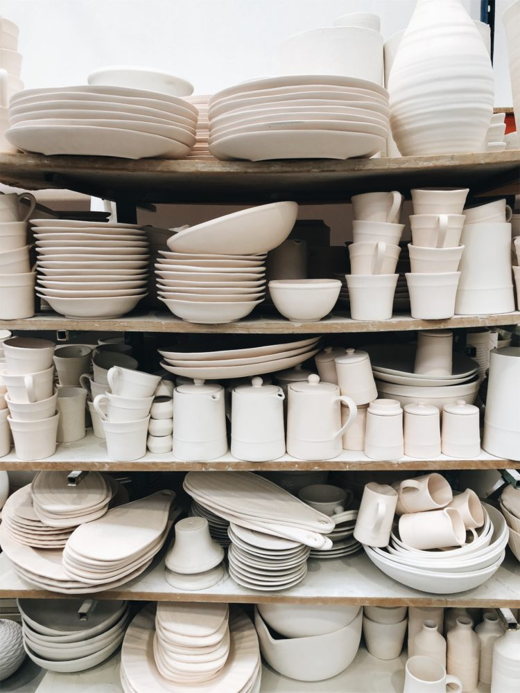 stacks of unfired ceramics drying at the factory in Alcobaça, Portugal