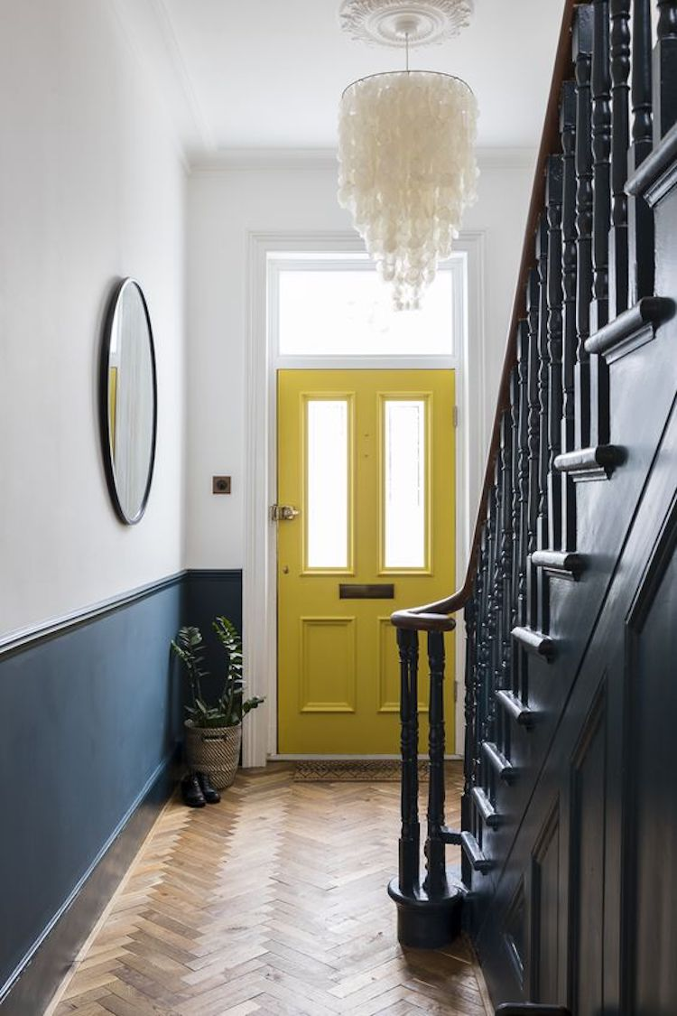 yellow door and half painted wall by imperfect interiors