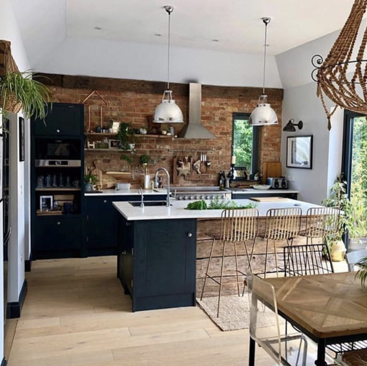 dark kitchen with exposed brick wall of Sharon @hornsby_style