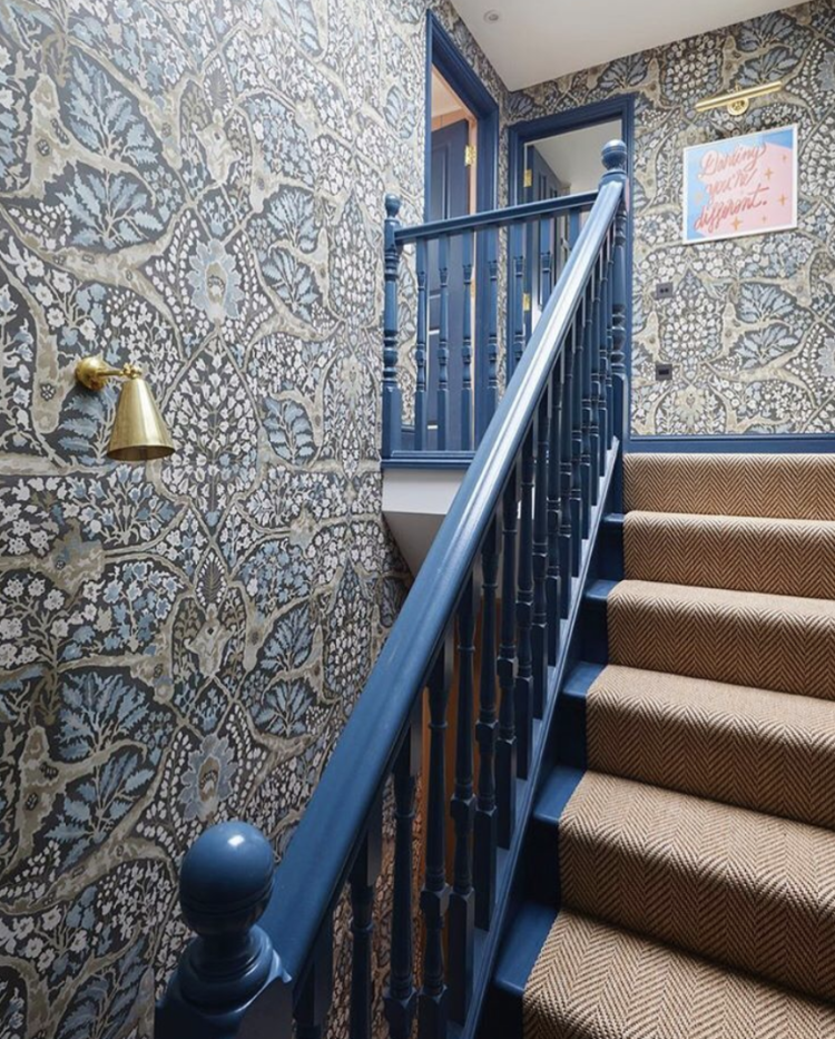 blue woodwork and floral wallpaper in the home of Sarah Brown Interiors, image by Snook Photograph