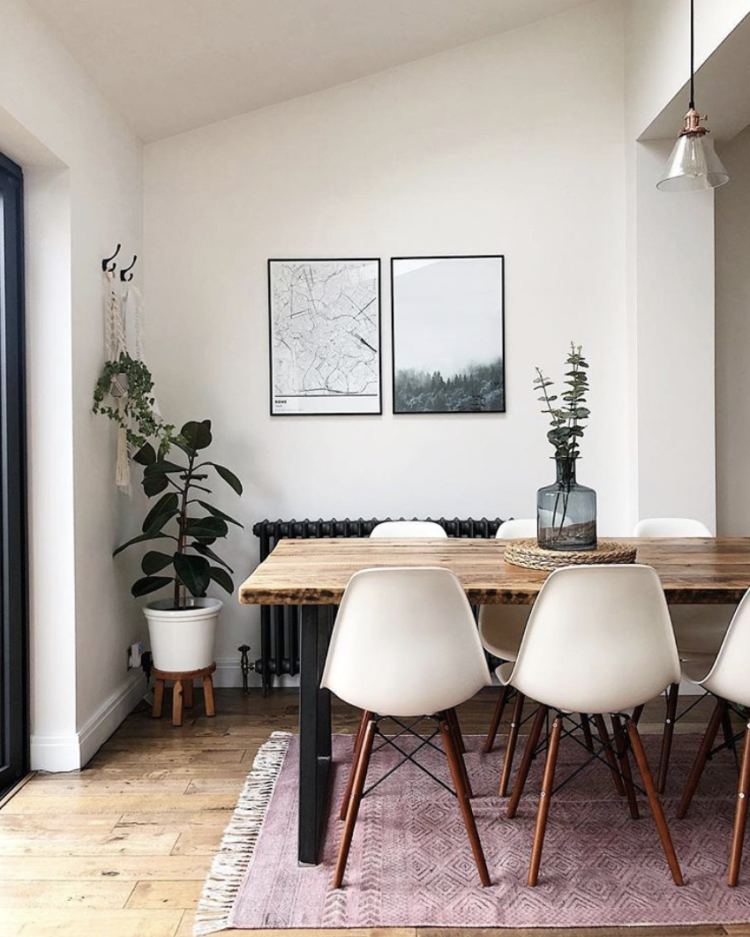 persian rug in neutral decor with eames chairs via charlotte asquith