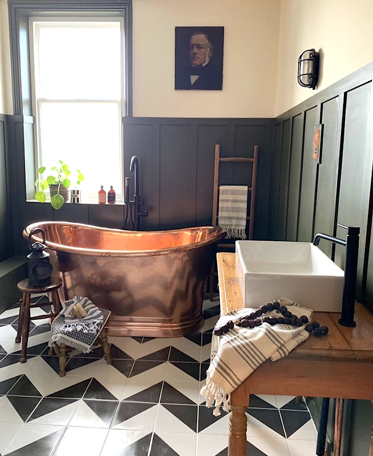 copper bath and wall panelling in the home of Nicola Broughton