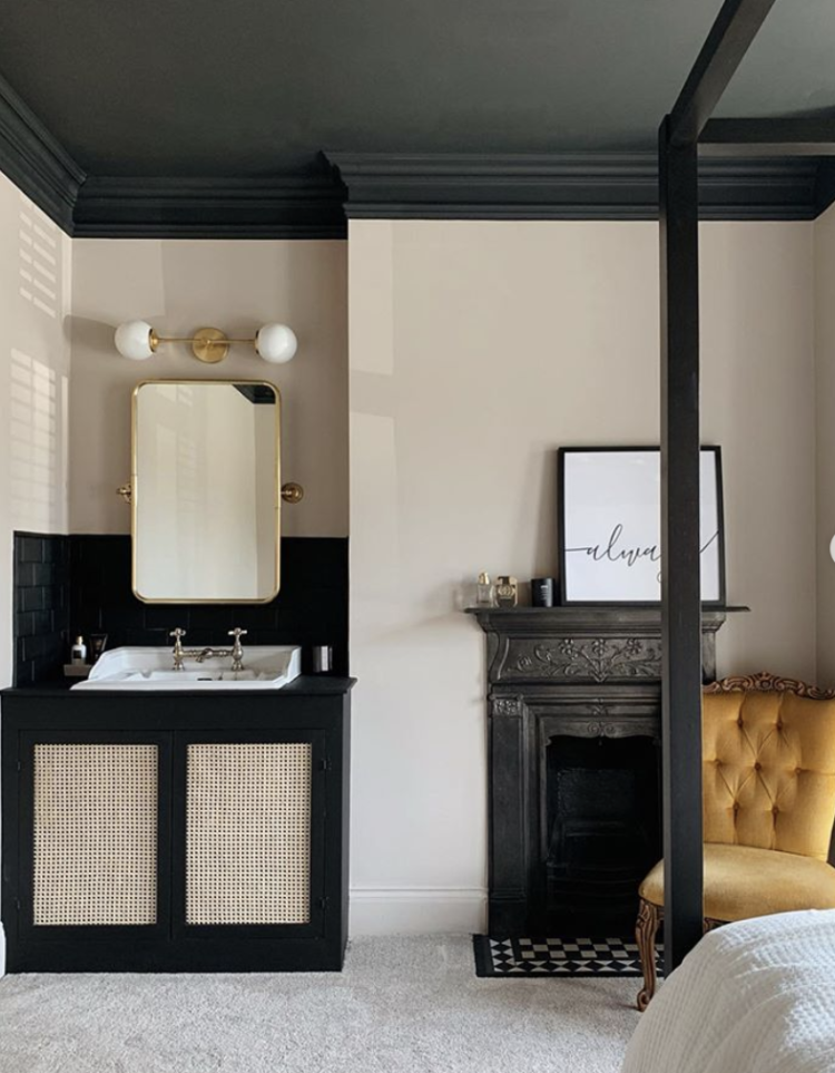 A look of some favourite beautiful rooms with Kate Watson-Smyth. This bedroom has a black painted ceiling but, in a clever touch, so is the coving all the way round. This has the effect of softening the hard line you get when the wall hits the ceiling at right angles and also bends the ceiling slightly down over the walls making it look higher. The black vanity unit is softened with some cane detailing and gold accents. #bedroom #blackceiling #madaboutthehouse