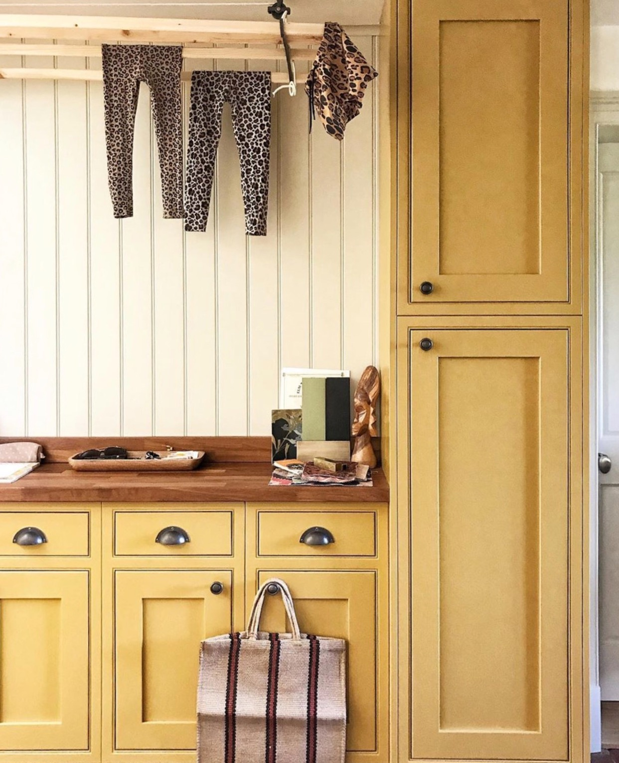 yellow kitchen with leopard laundry image by @ericadavies of @our_essex_house_renovation