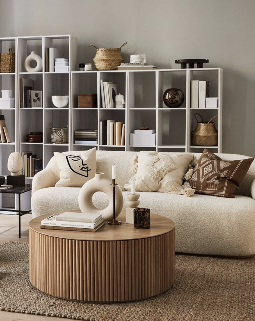 Kate Watson-Smyth reports on one of the latest interior trends reeded and fluted deisgns. This living room by HM Home fetaures a round fluted coffee table and lots of natural elements and textures. #madaboutthehouse #livingroom #trends