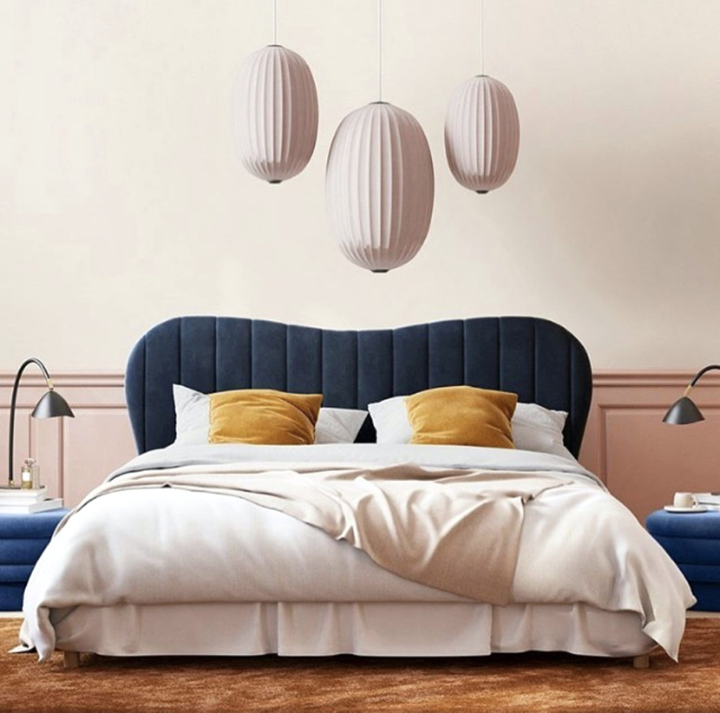 Kate Watson-Smyth looks at ways of injecting touches of mustard to scheme. Here a pale pink bedroom with navy headboard and side tables has the simple addition of mustard cushions to liven the scheme. #mustardaccents #madaboutthehouse #bedroom