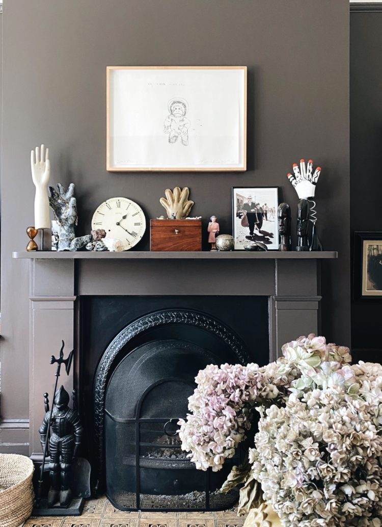 my mantelpiece is a collection of family souvenirs and happy memories