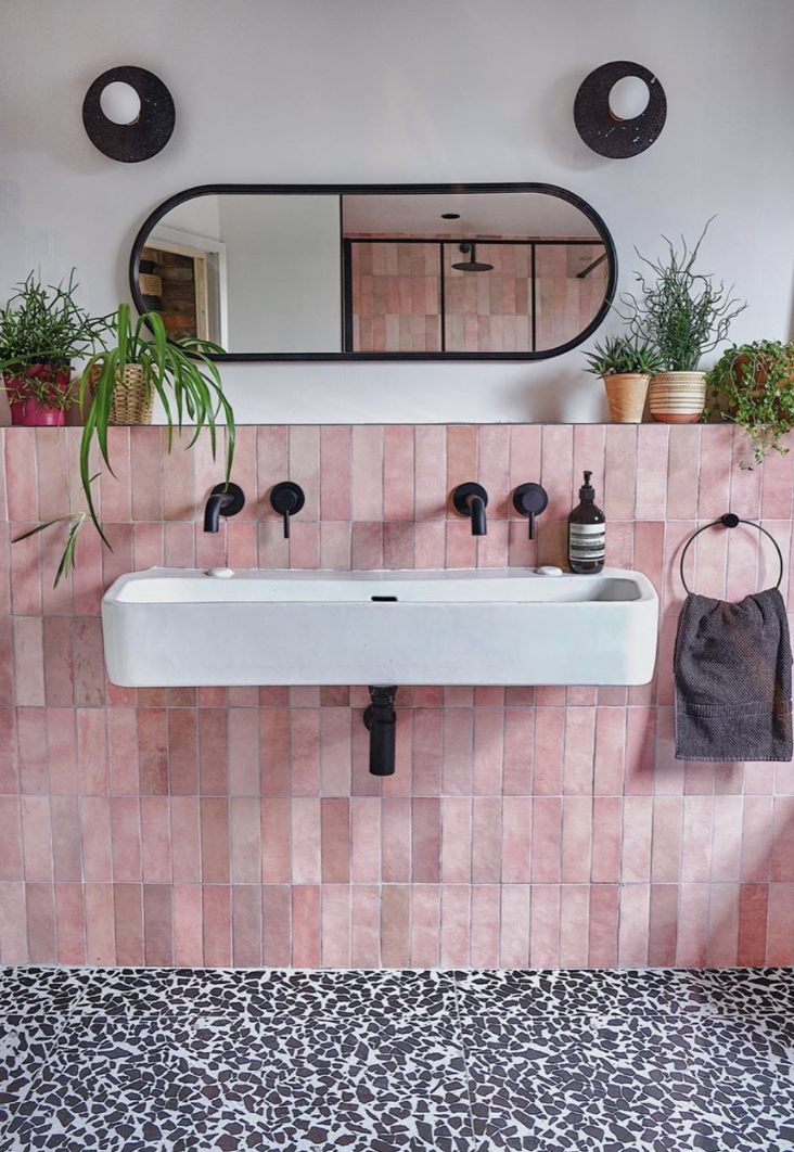 pink tiled and terrazzo bathroom by emilie fournet interiors