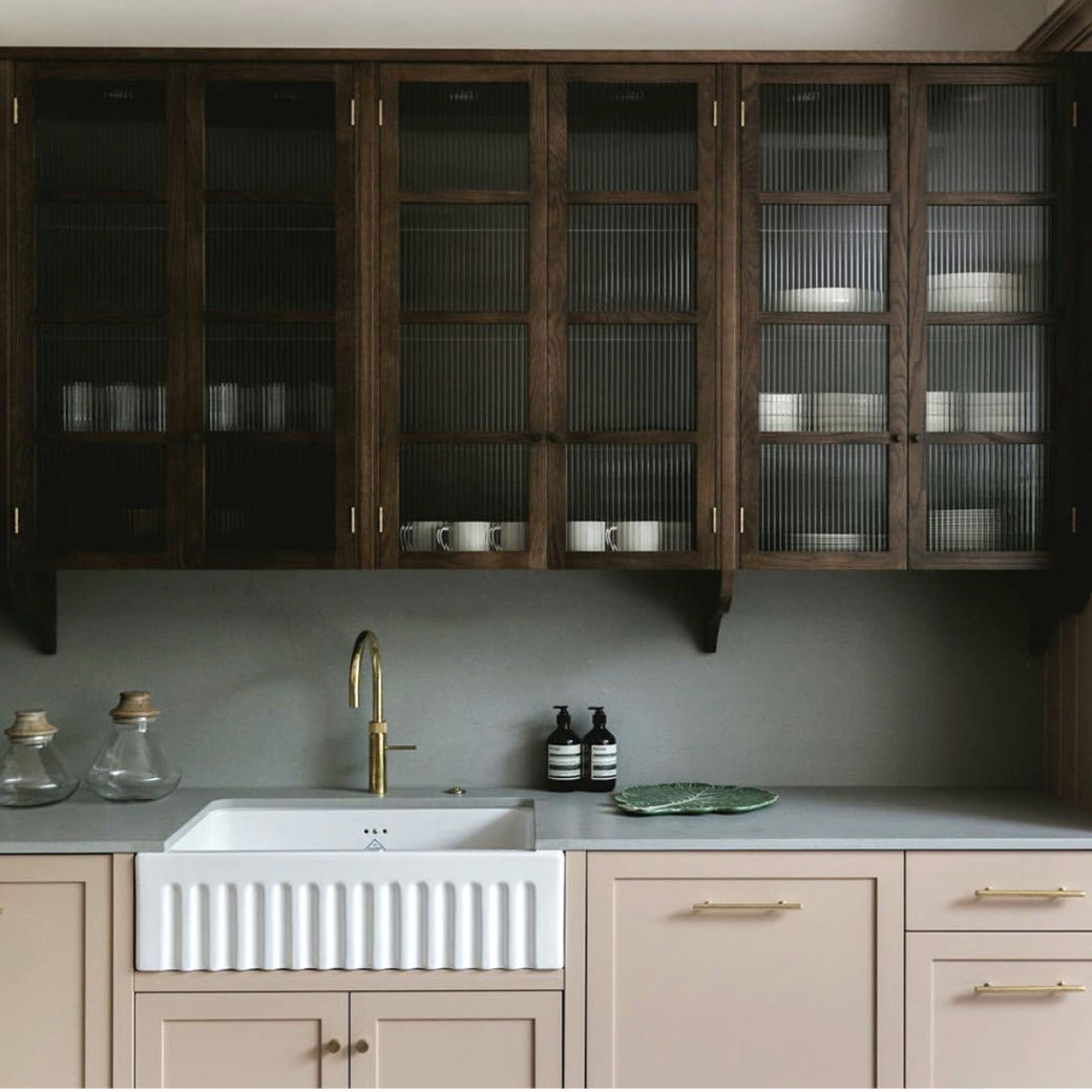 pink and wooden kitchen design by studio duggan and 202 design photo by mariell lind hansen