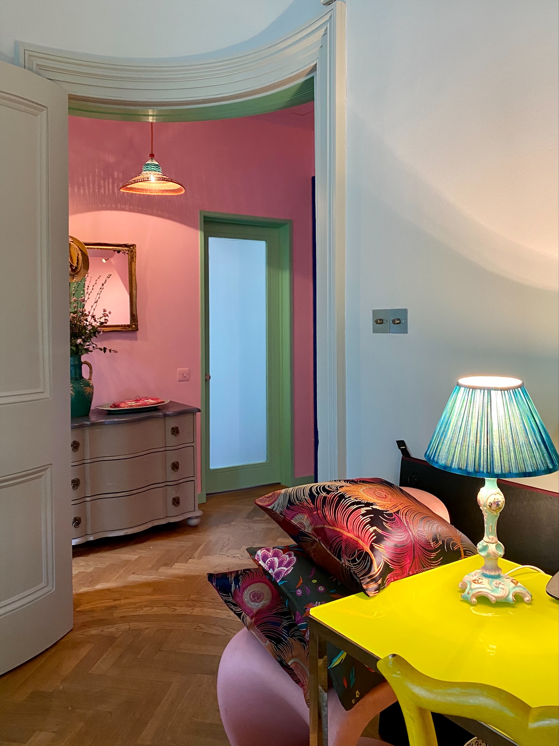 Matthew Williamson soft grey walls with pops of bright colour