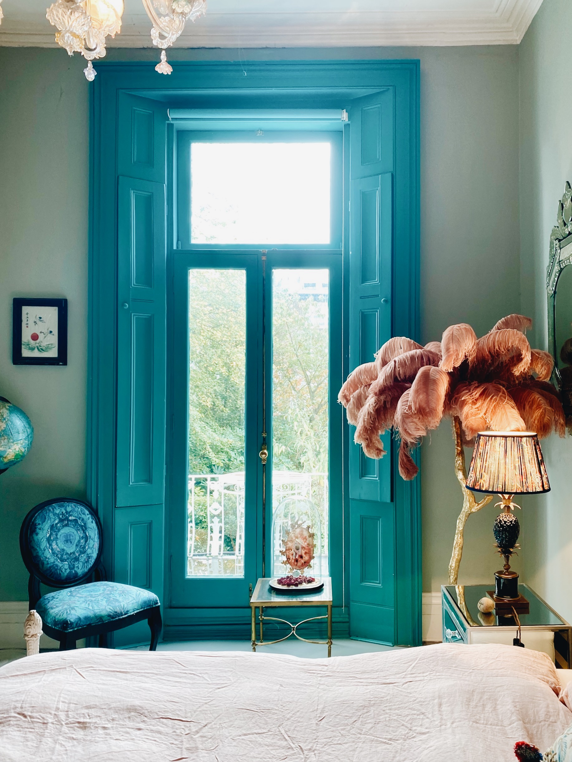 Turquoise windows at the London home of Matthew Williamson