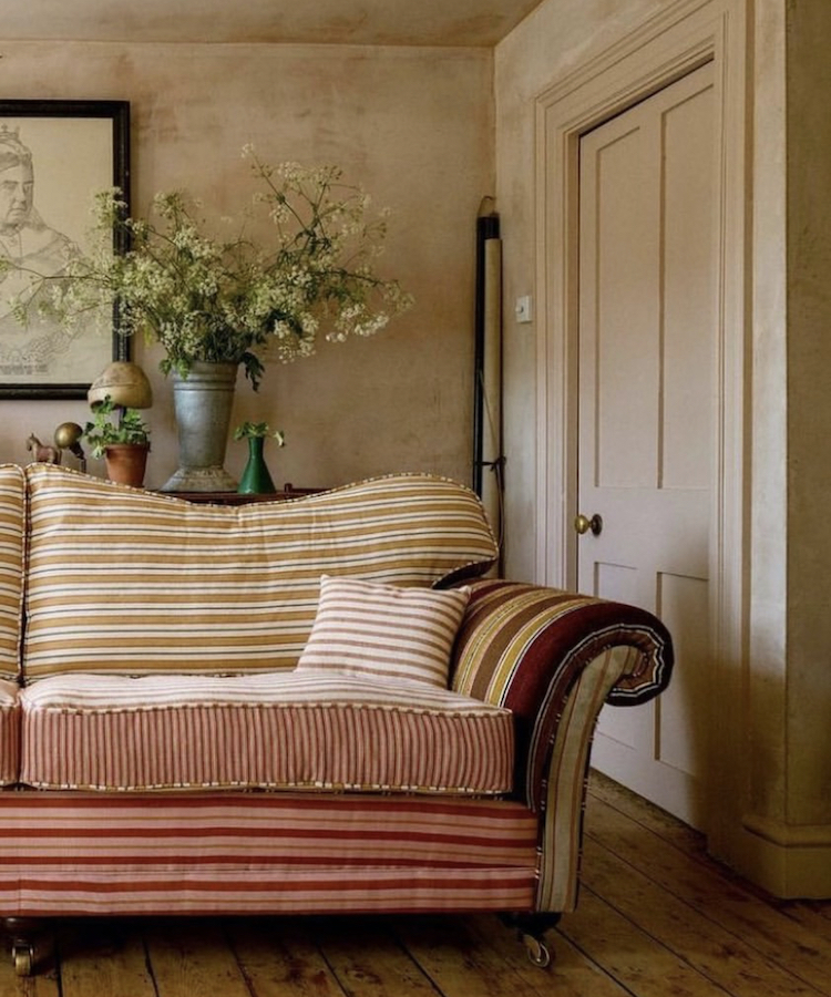 striped sofa in the home of @cotedefolk image by charlotte bland